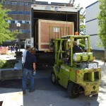 Forklift begins easing the first crate out of the truck. Photo dated September 6, 2011