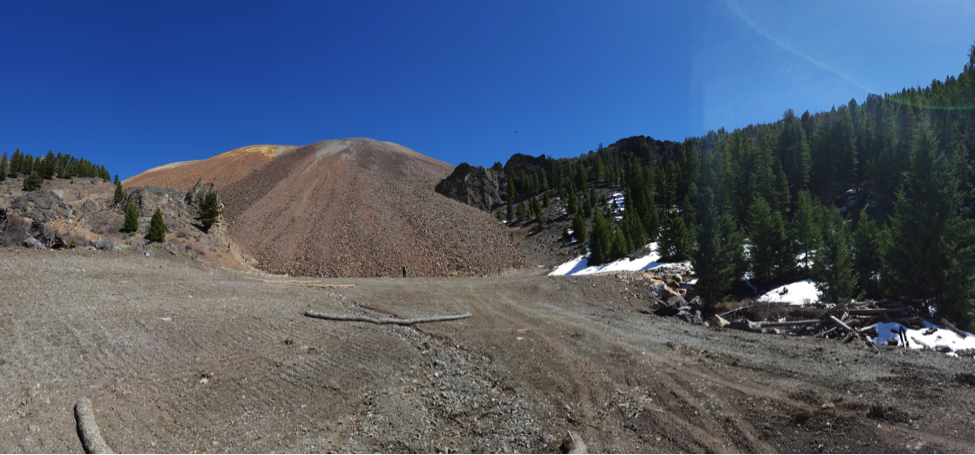 Panorama of a large waste rock dump being studied as part of this project. Note the worker standing in front of the dump for scale!